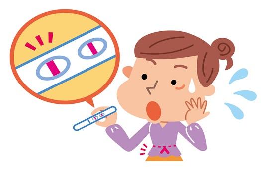 女性と妊娠検査薬